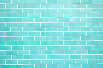 Turquoise new brick wall perfectly background. Best clean green pastel brick wall. Close up. Front view.