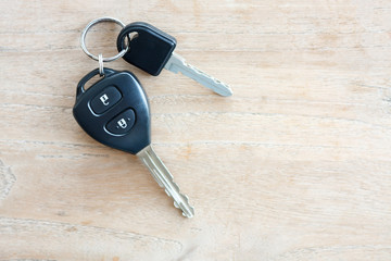 Car Key on wood background