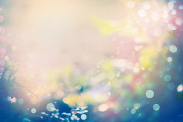Pretty abstract blurred nature background with sunshine and bokeh