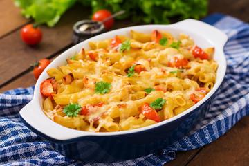 Pasta casserole, tomato, bacon and cheese