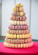 Macarons on pyramid-shaped plastic stand on many visible levels