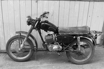 Retro motorcycle. Black and white photo. Old vintage card.
