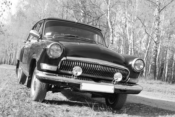 Retro car. Black and white photo. Old vintage card.