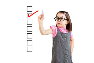 Cute little girl wearing business dress and checking on checklist box. White background.