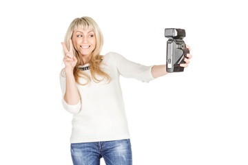 portrait of young woman taking selfie on retro camera. isolated on white background. vintage and lifestyle concept