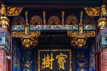 Architectural details of the entrance to Khoo Kongsi Temple, Penang, Malaysia