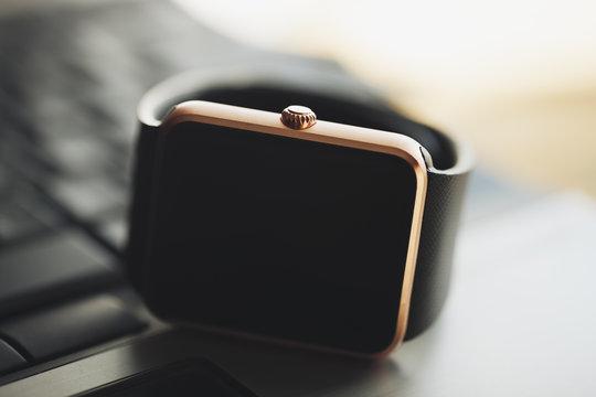 Smart watch on laptop keyboard