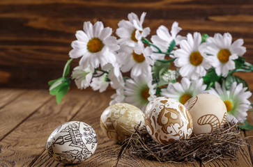 painted Easter eggs and fresh flowers, on a white background