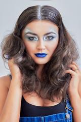 Beauty girl, blue lips, silver eyeshadow. Snowy hair. Young model