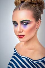 Portrait of beautiful young woman, creative makeup.  Fashion photo concept.