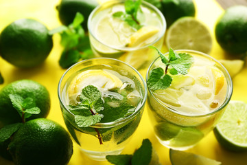 Mojito drinks with lime, lemon and mint, closeup