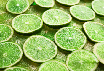 Green background of sliced lime