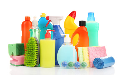 Detergent bottles and cleaning supplies isolated on white