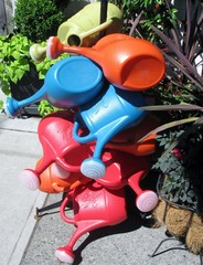 Stock of colored plastic watering cans