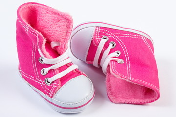 Pair of baby shoes on white background, expecting for baby