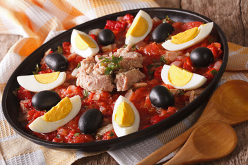 Arabic Mechouia salad with vegetables, tuna and eggs close-up