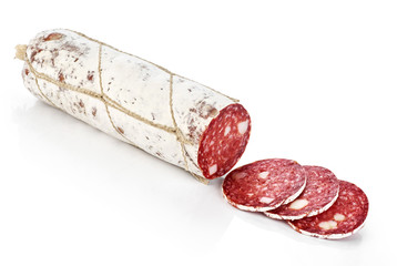 Dried salami with white mold isolated on white background.
