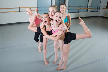 Photo on textile frame Dance School Group of young girls having fun in dance studio