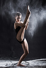 Dramatic portrait of strong teenage dancer with white powder exp
