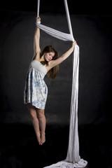 Aerialist doing tricks on silks