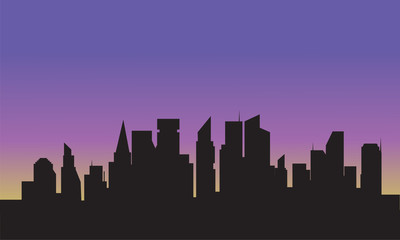 Silhouette of city with purple sky