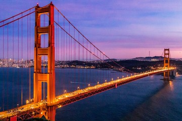 Fotomurales - Time-lapse of colorful sunset at the Golden Gate Bridge in San Francisco, California, USA