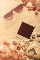 sea shells, sunglasses and polaroid picture
