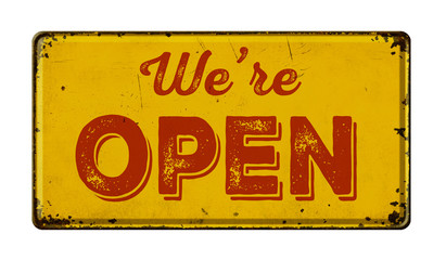Vintage rusty metal sign on a white background - We are open