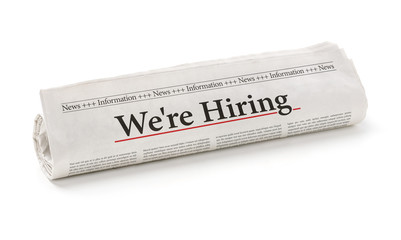 Rolled newspaper with the headline We are hiring