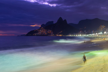 Night view of Ipanema beach and mountain Dois Irmao (Two Brother) in Rio de Janeiro, Brazil