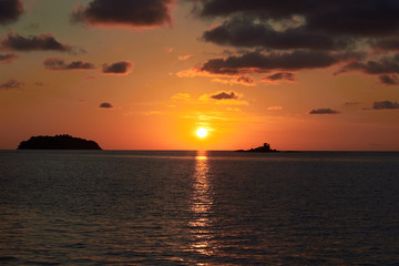 Sunset in Thailand, Koh Chang island. Orange sun and ocean.