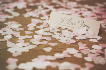 Place tag surrounded by heart shaped confetti