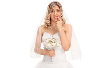 Nervous young bride biting her nails