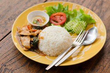Thai food,spicy fried pork with pepper and jasmine rice
