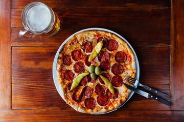 Delicious Peperonie Peperuncino Pizza and Beer