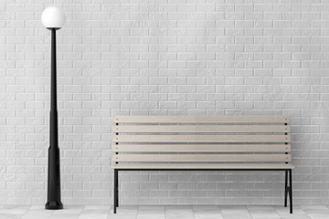 Wooden Bench and Street Lamp against white brick wall