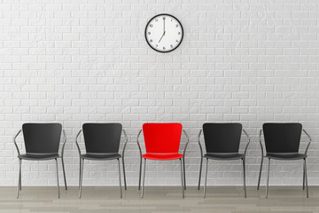 Red Chair with Another Black against wall with Modern Clock