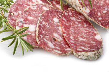 pork salami sliced on a white background