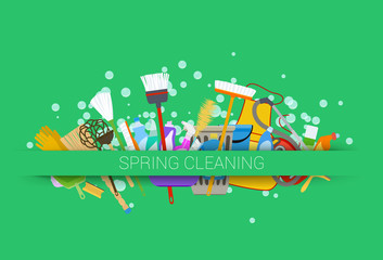 spring cleaning supplies green background. tools of housecleaning