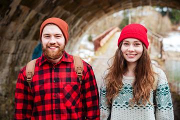 Portrait of happy couple standing outdoors in winter