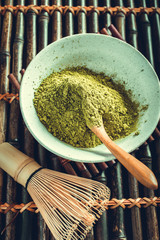 Matcha ground with spoon and whisk