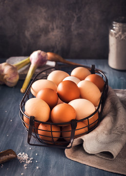 Eggs in wire basket on rustic table