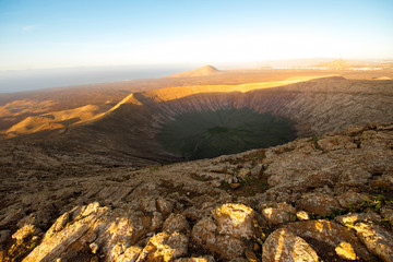 Breathtaking view on the crater of Caldera Blanca volcano on the sunset on Lanzarote island in Spain
