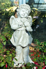 Statue of an angel playing the violin in the park