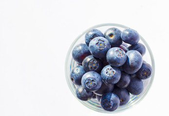 Fresh blueberries in glass background