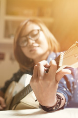 Asian girl with the guitar.