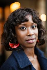 Black woman posing in the street
