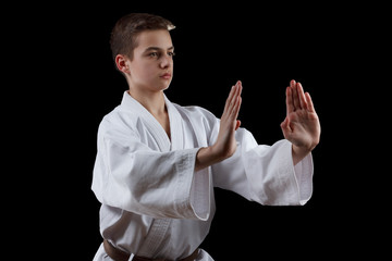 Karate Fighter in white Kimono Isolated on Black