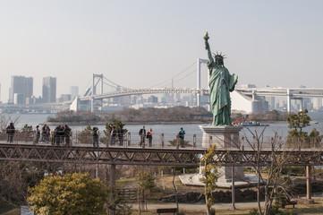 Statue of Liberty and Rainbow bridge in Tokyo, Japan.