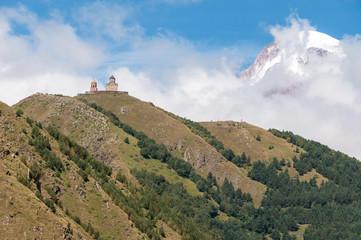 14th century Holy Trinity Church near Mount Kazbek, Caucasus, Georgia.